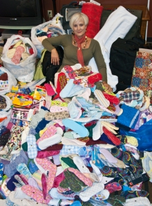 """Deb Dawson in a pile of donated panties after """"Get Your Panties in a Bunch."""""""